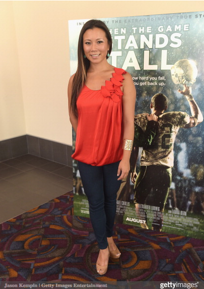 Journalist Angela Sun attends the LA Youth Sports Outreach Screening Of 'When The Game Stands Tall' at Regal 14 at LA Live Downtown on August 3, 2014